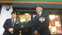 Jack Colbert from the Royal British Legion, shop owner Jeff Cheetham and standard bearer Ian Mackie outside the shop