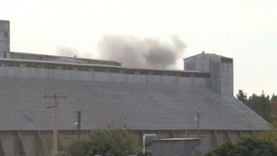 Smokes rises from a building on the Turkish border with Syria