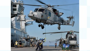 A Royal Navy Wildcat helicopter on exercise with HMS Ocean