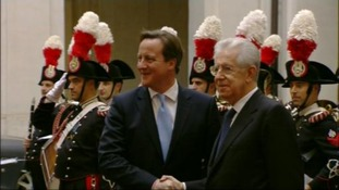 David Cameron is pictured shaking hands with his Italian counterpart Mario Monti.
