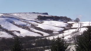 Snowy hills.
