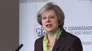 Theresa May vows to tackle 'completely unacceptable' mental illness 'stigma'