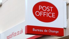 A file photo of a Post Office sign.