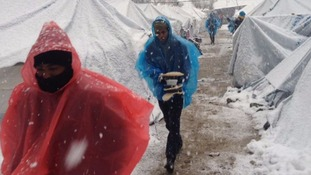 Refugees in Greece face the snow with just a poncho