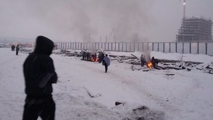 People huddle round fires for warmth in -13C in Serbia