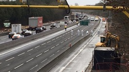 Forensic teams investigating after body found on M1