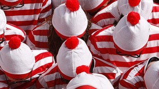 A man dressed as Where's Wally has been given a three month driving ban for driving without a licence and insurance