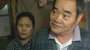 Long Li Hua and her husband Zhang Xingjian say 'we don't have human rights'