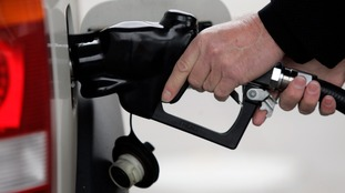 A driver fills up his car with petrol.