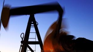 An oil pump works in the Persian Gulf desert field of Sakhir, Bahrain.