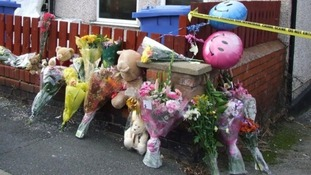 Shocked residents left flowers and toys after the blaze