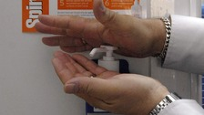 File photo: A person using an alcohol hand gel