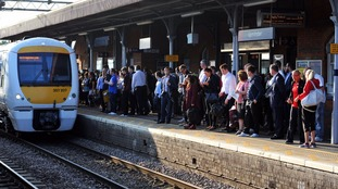 Commuters waiting for a train on the c2c line at Upminster station