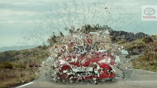 The ad featured the car bursting through a barrier