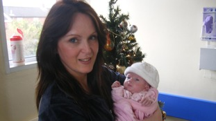 Paula Stevenson holding her daughter, Hayley Fullerton who died at Birmingham Children's Hospital one month after her first birthday