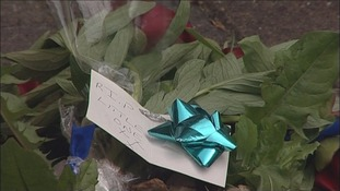 Flowers at the scene house where Poppy died