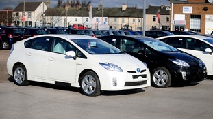 Toyota Prius hybrid cars inside a compound near a Toyota showroom in Burton on Trent