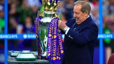 Leicester City Ambassador Alan Birchenall puts the Premier League trophy on the winners podium.