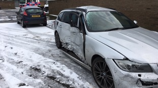 One of the cars damaged in the collision
