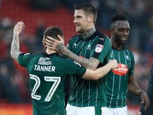 Plymouth Argyle's Sonny Bradley (right) and Craig Tanner after the final whistle during the Emirates FA Cup, Third Round match at Anfield, Liverpool.