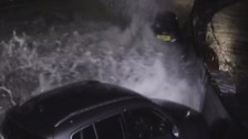 Waves slam cars against wall during Kent storms