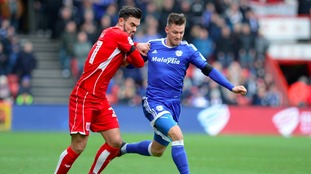 Cardiff City's Anthony Pilkington (right) and Bristol City's Marlon Pack battle for the ball