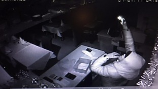 A CCTV image from the raid on Taherah Indian restaurant.