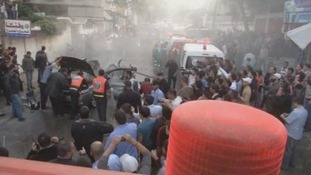 Palestinians gather at the scene of an airstrike