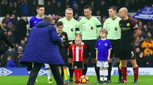 Bradley Lowery on to the pitch with Everton captain Gareth Barry and Manchester City captain Pablo Zabaleta.