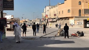 Protesters in Bahrain block a road following news of the executions
