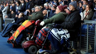 Disabled supporters attend a football match.