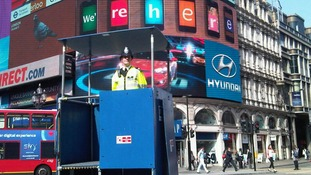 An officer uses special podium to monitor crowds in the West End.