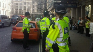 Police stop a car in the West End