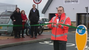 Dep Eddie Noel cuts a ribbon