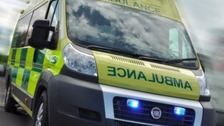 A woman has been treated for a serious abdominal injury and taken to University Hospital Coventry and Warwickshire