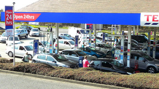 Cars queue for petrol at a Tesco petrol station