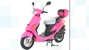 A scooter similar to the stolen one which had black stickers on the side panel.