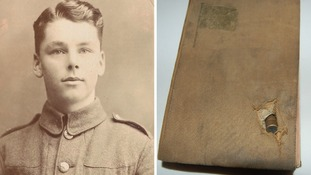 Leonard Knight, 17, and the Bible embedded with a WW1 bullet.