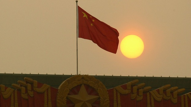 The national flag flies from the top of the National Museum of China, opposite of the Great Hall of the People