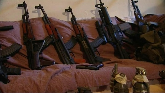 Guns and grenades displayed at an arms dealer's home in Lebanon