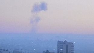 A plume of smoke rises over the view of the Gaza Israeli border this morning