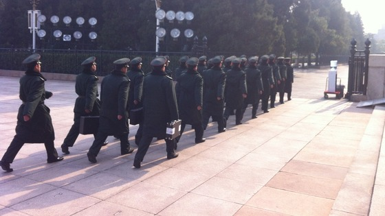 Soldiers marching outside the Great Hall of the People