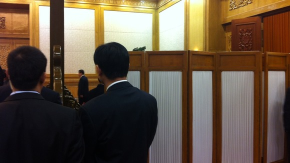 The moment Xi Jinping was just about to walk out from behind a screen to face the world for the first time as the new leader of China
