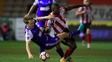 Ipswich Town's Christophe Berra and Lincoln's Theo Robinson battle for the ball