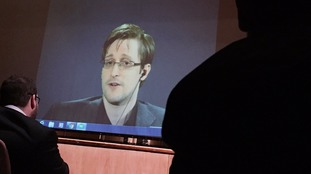 Former National Security Agency contractor Edward Snowden, speaks via video conference.