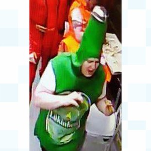 Man dressed as beer bottle