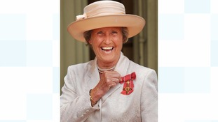 Rachael Heyhoe Flint collecting her OBE