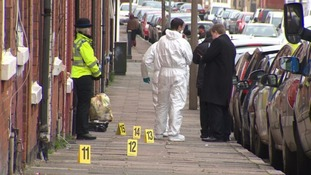Forensic officers were seen examining the area.