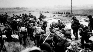Royal Marine commandos moving off the Normandy Beaches during the advance inland from