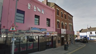 A woman was taken to hospital with facial injuries in nightclub brawl